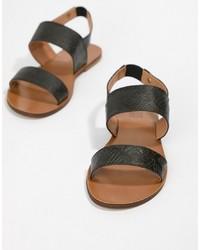 Sandales plates en cuir noires Love Moschino