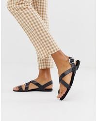 Sandales plates en cuir noires Monki