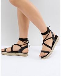Sandales plates en cuir noires Pieces