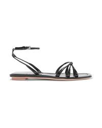 Sandales plates en cuir noires Prada