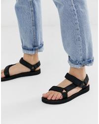 Sandales plates en cuir noires Teva