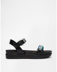 Sandales plates en cuir ornées noires Love Moschino