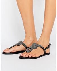 Sandales plates en cuir ornées noires Pieces