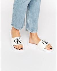 Sandales plates en toile blanches