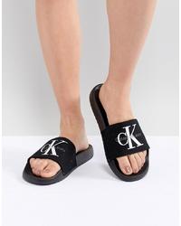 Sandales plates en toile brodées noires Calvin Klein
