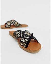 Sandales plates en toile brodées noires Toms