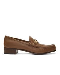 Slippers en cuir marron Gucci