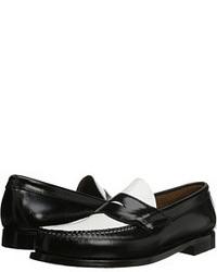 Slippers en cuir noirs et blancs
