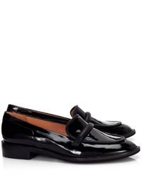 Slippers en cuir noirs