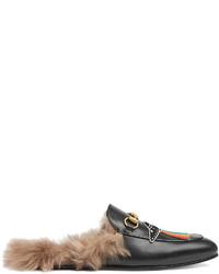 Slippers en cuir noirs Gucci