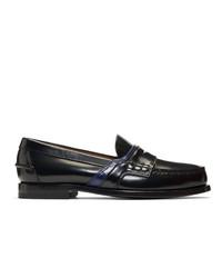 Slippers en cuir noirs Prada