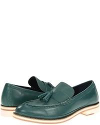 Slippers en cuir vert foncé