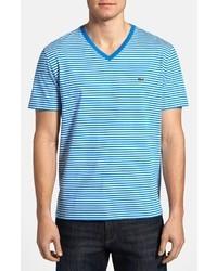 T-shirt à col en v à rayures horizontales blanc et bleu