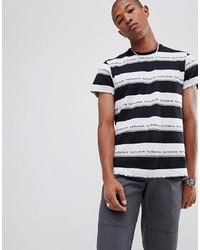T-shirt à col rond à rayures horizontales blanc et noir HUF