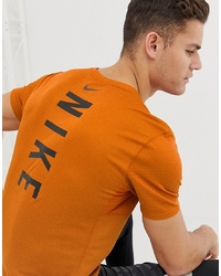 T-shirt à col rond imprimé orange Nike Running
