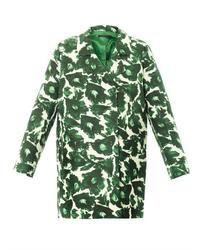 Vêtements de dessus verts